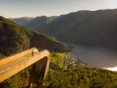 Aerial View. Tourist Woman Enjoying Fjord View Aurlandsfjord Landscape From Stegastein Viewing Point poster