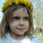 Serious Girl With Dandelions On Her Head