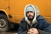 Poor Homeless Man Sitting Near Van Outdoors poster