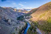 sunset and moon rise over mountain river canyon - Poudre River in northern Colorado aerial view in e poster