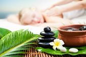 Spa Massage Outdoor. Beautiful Young Woman Getting Spa Massage. Focus On Spa Object poster