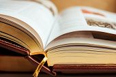 Close Up Of Large Book Pages. Large Open Book On Stack Of Books. Educational Background. poster