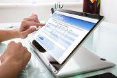 Businessperson Filling Online Survey Form On Digital Laptop poster