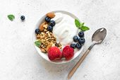 Granola With Yogurt And Berries For Healthy Breakfast. Bowl Of Greek Yogurt With Granola, Almonds, B poster