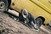 Poor Homeless Man Lying Near Van Outdoors poster
