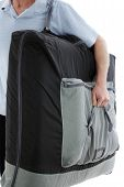 stock photo of home remedy  - Professional licensed massage therapist man carrying a portable massage table on his way to do a outcall massage therapy for a client at his home - JPG