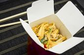 Wok With Noodles, Chicken And Vegetables In Carton Box To Go And Bamboo Chopsticks poster