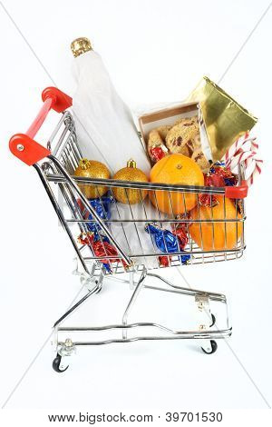Shopping cart with Christmas gifts isolates on white background