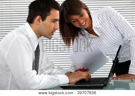 Office couple with a laptop