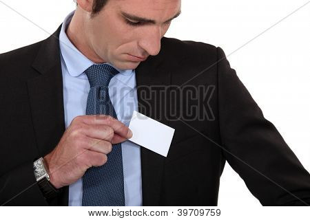 Man putting a business card into his pocket