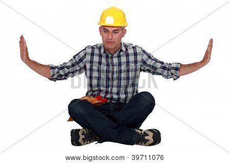 craftsman sitting in a meditation position