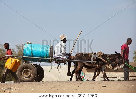 SUDAN - JANUARY 12: Sudanese peasant rides water carrier to the source near Khartoum on January 12, 2010. Sudan remains one of the least developed countries in the world with water supply problem