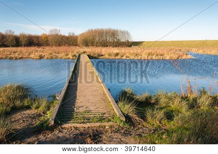 Wooden Gangway Over  Blue Rippling Water