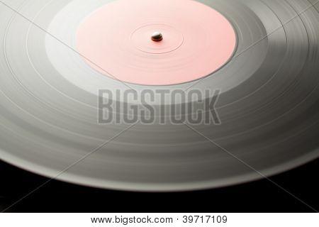 Spinning vinyl record. Motion blur image.