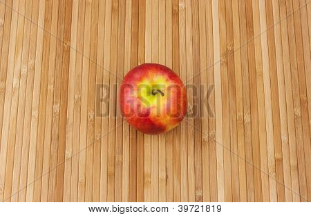apple lying on a bamboo napkin