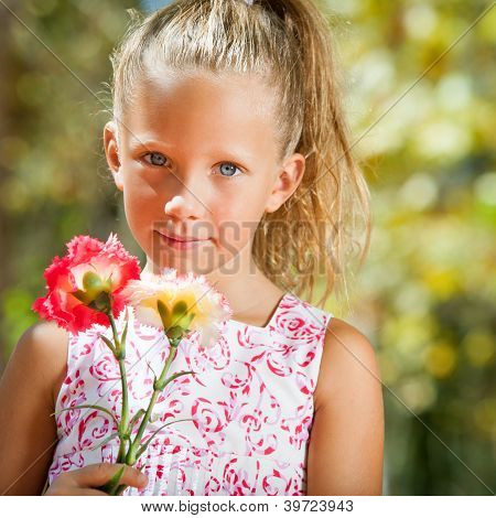 Cute Girl Holding Flowers.