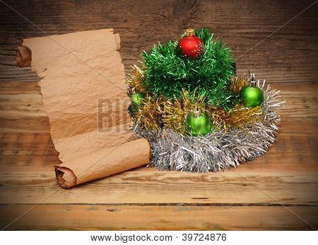 Christmas tree made of tinsel with old paper scroll