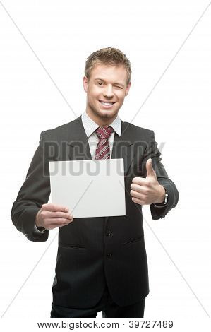 cheerful winking businessman holding sign