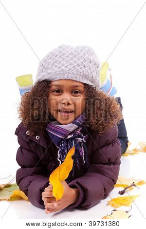 Little African Asian Girl Wearing Winter Clothes Playing With Leaf Trees