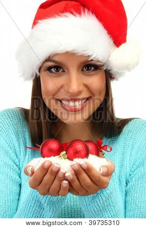 beautiful young woman holding snow with christmas balls, isolated on white