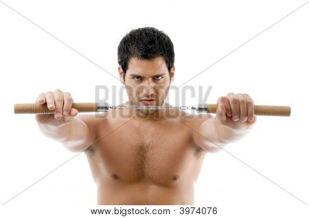 Portrait Of Young Man With Nunchaku