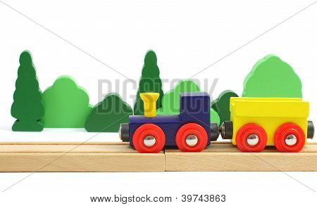Wooden Train On The Railroad And Trees   Isolated Over White
