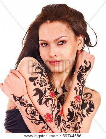 Woman with body art against graffiti brick wall.