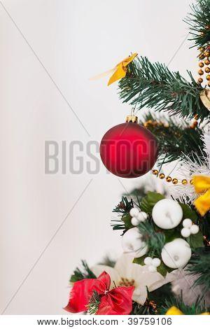 Closeup On Christmas Tree With Big Red Christmas Ball