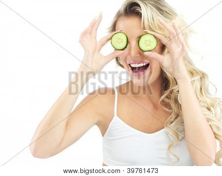 portrait of attractive  caucasian smiling woman isolated on white studio shot eating cucumber