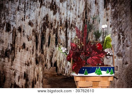 Christmas Basket On A Decayed Wood Background