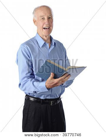 A senior man happily singing from a hymnal.  On a white background.