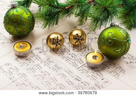 Christmas carol with jingle bells and candles