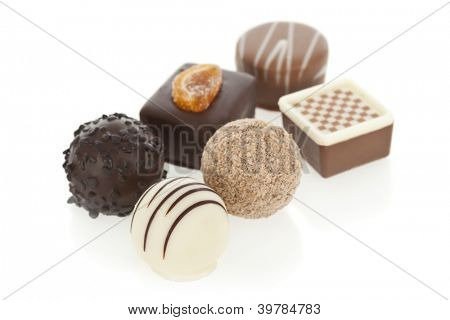 Gourmet chocolate bonbons isolated on white background
