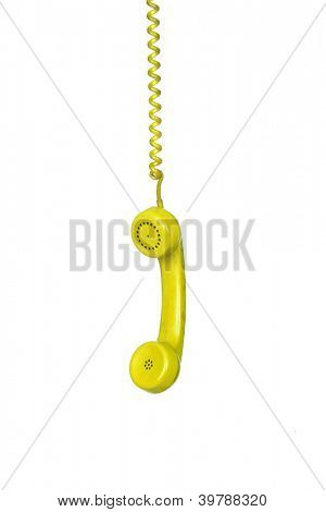 Yellow telephone cable hanging isolated on white background