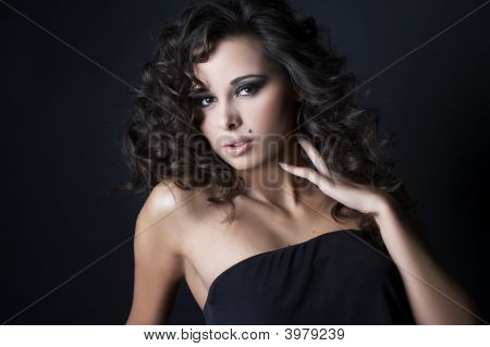 Beautiful Brunette Posing On Black Background In Studio