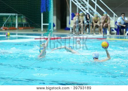 MOSCOW - MARCH 3: Men play water polo in pool, spectators, judge watch match at 7th round match of Russian Championship in water polo in Olimpiysky Sports Complex on March 3, 2012 in Moscow, Russia.
