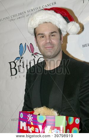 UNIVERSAL CITY - DEC. 4: Robert Burton arrives at publicist Mike Arnoldi's birthday celebration & Britticares Toy Drive for Children's Hospital on Dec. 4, 2012 in Universal City, CA.
