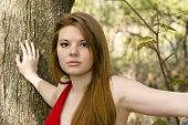 stock photo of pouty lips  - sexy brunette in red dress in forest - JPG