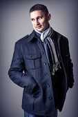pic of outerwear  - Young handsome sexy man in casual black coat and black and white scarf - JPG