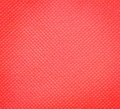 stock photo of nonwoven  - A Background Of Red Nonwoven Fabric Texture - JPG