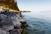Lake Garda Near Town Of Sirmione In The Evening, Lombardy, Italy