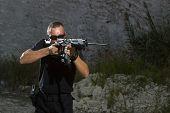 picture of shooting-range  - Man shooting on an outdoor shooting range - JPG