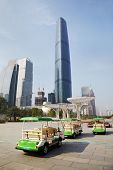 GUANGZHOU - NOV 23: Guangzhou International Finance Centre and square in front of it with standing e