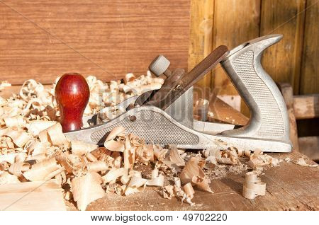 Jack-plan And Sawdust Laying In The Table