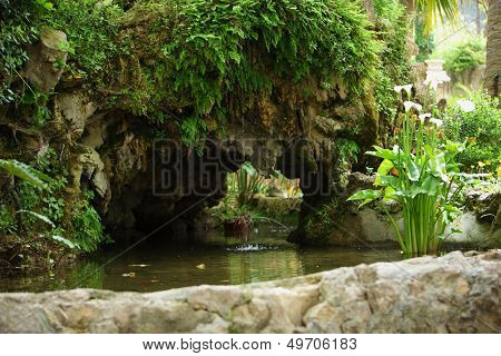 Ornamental Pond And Rock Wall