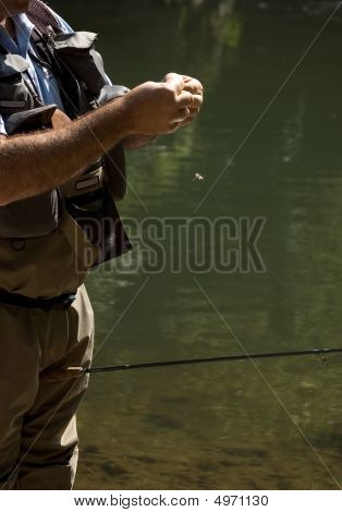 Fisherman Preparing The Bait or The Fly