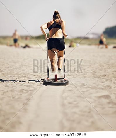 Woman Pulling Sled