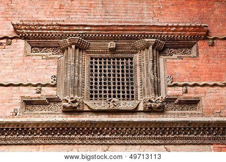 Carved wooden window on Hanuman Dhoka old Royal Palace Durbar Square in Kathmandu,  Nepal.