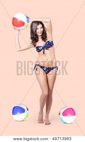 Beautiful  Bikini Woman Playing Summer Sport