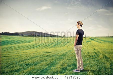 young boy admires landscape